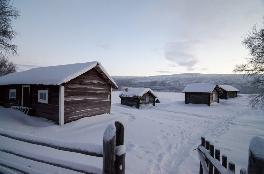 Bunch of the first cottages in the village of Utsjoki. Each cottage housed a family.