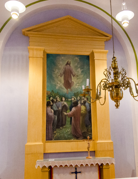 The painting behind the altar of the Utsjoki Church featuring a local family of that time