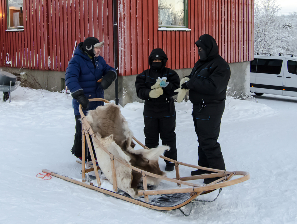 Getting the crash course on sled driving from Dag (Leftmost)