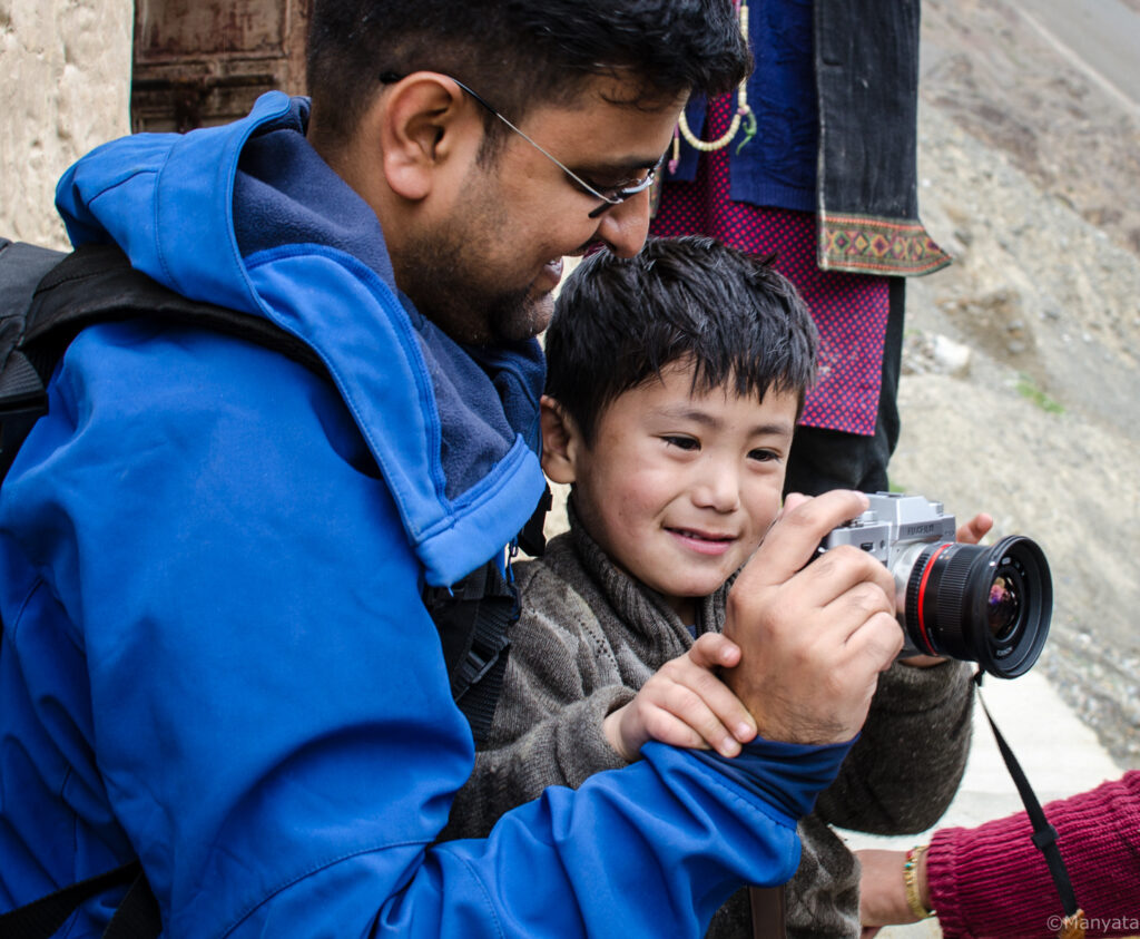 Our photography mentor teaching the kid how the camera works!