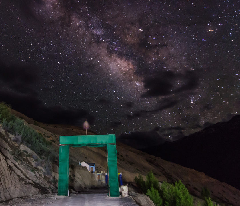 The bedazzling Milky way over the gate of Dhankar Village, finally peeking through the clouds after making us wait a few hours