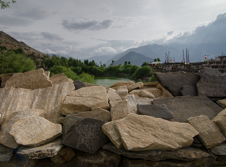 The wall of holy engraved stones and the Nako lake behind it like an oasis in this desert